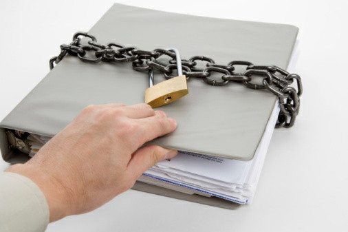 Lock and file folder, concept of Confidential Document